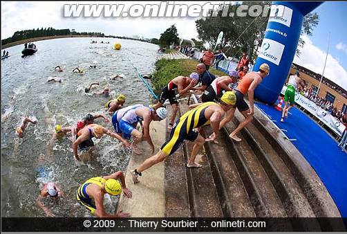 I believe that's me on the bottom of the screen in the yellow/dark blue suit just exiting the water behind my teammate, Alfred torok
